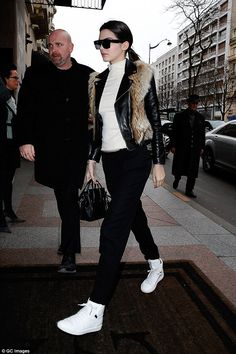 Kendall.. Celine Cl 41756/S Zz-Top, Saint Laurent Coyote Fur and Leather Jacket, Saint Laurent Leather High-Top Sneakers, and Celine Nano Bag..