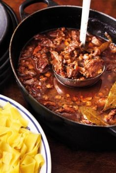 CARBONNADE A LA FLAMANDE - Belgian national dish - Stoovlees - is a simple yet so incredibly flavorful beef stew where the meat is cooked in the oven in black beer. Best served with French Fries or noodles and beer.