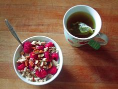 oatmeal with flax, hemp hearts, almonds, raspberries, and almond halva, and moroccan mint green tea