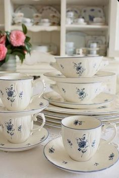 Delicate cream ware with blue flower detail....