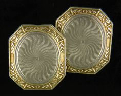 Elegant octagonal cufflinks with engraved white gold centers featuring radiant, swirling starbursts.  The yellow gold borders are decorated with floral and dart motifs.  Crafted in 14kt gold,  circa 1920.