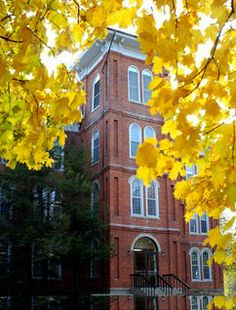 College Hall at Wilmington College features arched windows and classic style - Autumn view.