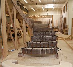 Shop built elliptical spiral stair by NK Woodworking & Design. Fabrication in process.