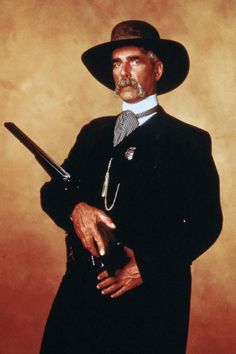 A gallery of Tombstone publicity stills and other photos. Featuring Kurt Russell, Val Kilmer, Sam Elliott, Bill Paxton and others. Sam Elliott, Val Kilmer, Hollywood Stars, Classic Hollywood, Tombstone Movie, Tombstone 1993, Tombstone Quotes, O Cowboy, Cowboy Gear