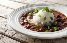 Venison Sauce Piquante - peanut oil or lard, flour, onion, green pepper, celery, garlic cloves, tomato paste, Cajun seasoning, venison, red wine, tomato puree or crushed tomatoes, bay leaves, Salt/pepper and hot sauce to taste, green onions or parsley for garnish