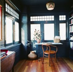 Enclosed porch.   love all the natural light!