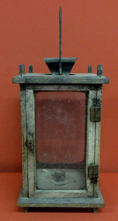 Early wooden candle lantern in old  paint -