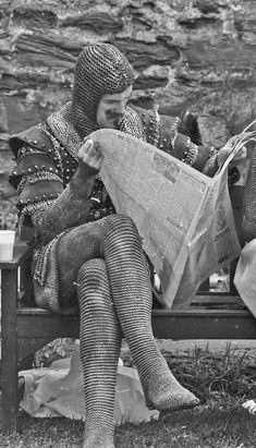 John Cleese taking a break on the set of Monty Python and The Holy Grail. 1975