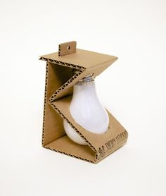 Emballage Michelle Wang, Light Bulb - Sustainable Packaging Design Your One Year-Old's Development T Packaging Carton, Egg Packaging, Cool Packaging, Brand Packaging, Packaging Ideas, Product Packaging Design, Shirt Packaging, Plastic Packaging, Corrugated Packaging