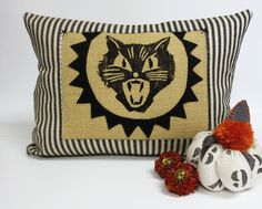 Scary Kitty Halloween Kidney Pillow. Halloween Kitty Cat Kidney Pillow - Burlap Pillow - Lumbar Pillow Decorative throw pillow cushion cover with whimsical gothic feel. The front of the cover is constructed in a black and ivory ticking cotton stripe. There is a burlap patch in reverse applique with a scary vintage inspired kitty cat face block printed in black fabric ink. Around the face, there is a geometric design with hand cut felt. The back of the cover is constructed out of a taupe...