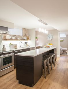 Basement kitchen with island and faux brick backsplash from HGTV's Income Property