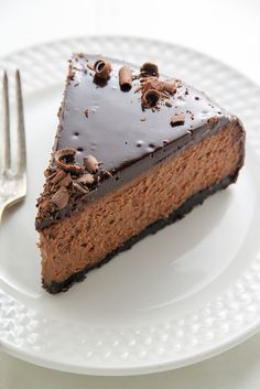 This Oreo Crusted Kahlua Chocolate Cheesecake is topped with Chocolate Ganache and chocolate curls! You're going to love this crowd-pleasing Kahlua Cheesecake! Kahlua Cheesecake After … Best Ever Cheesecake Recipe, Kahlua Cheesecake, Chocolate Cheesecake, Cheesecake Recipes, Chocolate Recipes, Dessert Recipes, Cookbook Recipes, Chocolate Lovers, Dinner Recipes