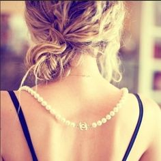Lovely updo, especially love the Chanel necklace.