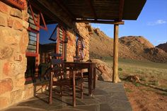 The terrace of a bungalow at Eagle's Nest Chalets. Horse Adventure, Eagle Nest, Namib Desert, Hotels, Main Attraction, Cabins In The Woods, Campsite, Lodges, Bouldering
