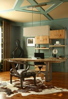 The shelving units behind this desk provide a mix of open display shelving  and closed sections 84c68cb4001f