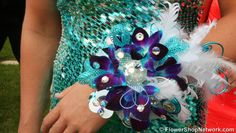 How To Corsage | This fun and feathery prom corsage uses blue orchids and shimmery blue ...