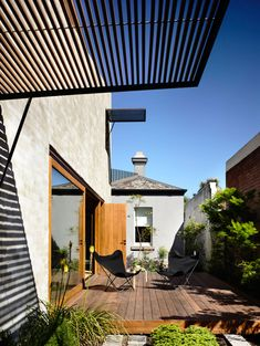East West House Hides a Secret Behind Its Victorian Facade… Outdoor Spaces, Outdoor Living, Outdoor Decor, Timber Deck, Timber Screens, Garden Design, House Design, Victorian Architecture, Contemporary Architecture