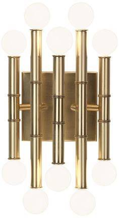 "Jonathan Adler Meurice 12"" High Antique Brass Wall Sconce - This exquisite metal wall sconce comes in a classic antique brass finish with a design that showcases the mid-century style globe candelabra bulbs. The design is transitional, with modern materials blending with a tropical, almost bamboo like, feel. (240.00)"