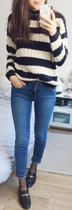 #winter #outfits  blue and white knitted stripped sweater and blue denim jeans outfit
