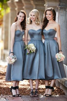 The fashion-forward midi length of this satin dress will take your bridesmaid's…