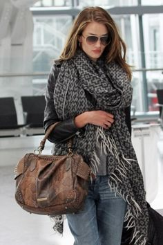 great traveling scarf, great with jeans (Rosie Huntington-Whiteley arrives at Heathrow in a giant patterned wrap, from The Vogue Diaries)