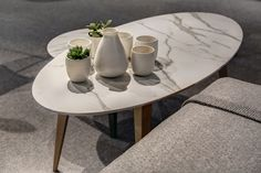 These beautiful tables done with #Neolith #Calacatta (designed by #Ondarreta) were showcased in the last edition of #EuroCucina. Visit our website to discover more #furniture #designs and share your favourite images! www.thesize.es/neolith/en/applications/furniture