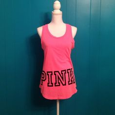 """ON HOLD NWT PINK graphic tank Brand new VS PINK graphic tank. Solid pink with """"PINK"""" graphic on the front and back. Size Small but could fit up to a large. Price firm, no trades. PINK Victoria's Secret Tops Tank Tops"""