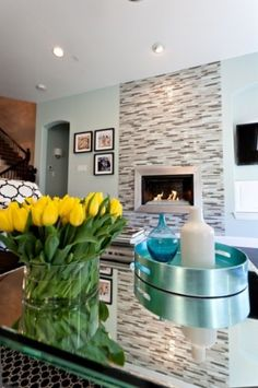 like silver fireplace surround with tile background - maybe different color tile - and offset TV