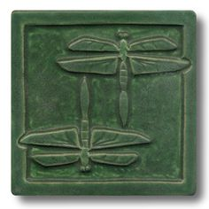 Each Whistling Frog tile begins with sculpting the original designs. Molds are made, clay impressions are poured and kilns fired, using their own glaze formulas. Whistling Frog Tile Company create artistic, handmade ceramic tiles and cabinet hardware, drawer pulls, in the Arts and Crafts tradition. Designs include: birds, cats, various critters, botantical florals, and figurative imagery.