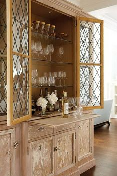 A fabulous dry bar was crafted from old barn floorboards & leaded glass windows.