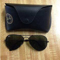 Black Ray-Ban Aviators Black Ray-Ban Aviator flat metal. They are a pilot shape with a thin and lightweight frame. Glasses have been gently used but have been taken care of so they are like new! No scratches or marks! Ray-Ban Accessories Sunglasses