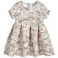 Baby girls grey and beige dress by Monnalisa Bebé, made in neoprene with a cute teddy bear print. The skirt is full, with inverted pleats all around and a concealed zip fastener at the back. It would look super with little beige or grey pumps.