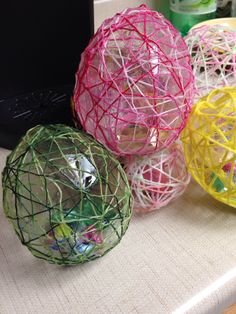 Easter eggs! An easy, messy project with the kids. Blow up balloons stuffed with candy, wrap with glue coated string or yarn, let dry, pop balloon and pull out the balloon pieces!