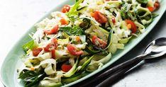 Wafer-thin shavings of zucchini dressed with fresh seasonal vegies create a light yet satisfying raw pasta dish.