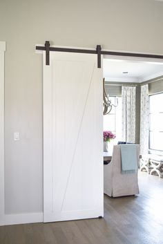 Whether you want to buy or DIY, here is an amazing round up of ideas for sliding barn doors and hardware. Sliding Barn Door Track, Barn Door Hinges, Barn Door Hardware, Barn Doors, Diy Bathroom Decor, Diy Door, Picture Frames, Rustic Barn, Door Ideas