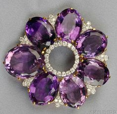 18kt Gold, Amethyst, and Diamond Pendant/Brooch, set with seven large, oval-cut Amethysts with Platinum and full-cut Diamond accents, 31.2 dwt, lg. 2 1/4 in. Estimate $2,000-3,000
