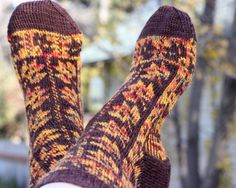 Mabon Leaves Socks Fair isle stranded colorwork by KunstwerkDesigns. Come celebrate those crisp fall days by jumping into a pile of leaves with Mabon Leaves socks. Maple leaves in vertical panels and reversed horizontal borders give the socks their cheery autumnal look. The pattern includes easy to follow written instructions with charts for sizes small, medium and large. Click through to purchase pattern. #mabon #Kunstwerk Designs