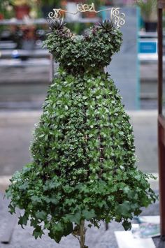 "This living strapless party frock grown from succulents and ivy (front view shown here) was entered in the ""plants grown on stuffed forms"" competition class at the @PA Horticultural Society's 2013 Philadelphia Flower Show. Photo by Patrick Montero for Organic Gardening"