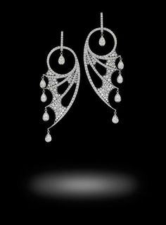 Jewels Verne Earrings by Stephen Webster, 18ct white gold pavé set with 5.17cts of white diamonds and diamond pear shaped drops