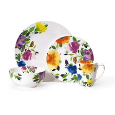 The Kim Parker dinnerware set features bright lively florals for a modern twist on a traditional look. Special details include a decal on the back of the plates and on the interior of the bowl and mug.