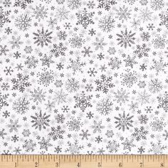 Seasons Greetings Snowflake Grey from @fabricdotcom  From Fabri-Quilt, this cotton print is perfect for quilting, apparel and home decor accents.  Colors include white, grey and accents of metallic gold.