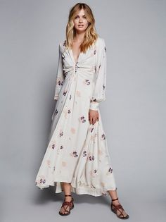 Brixton Maxi  | Super soft and breezy maxi dress with a beautiful femme floral print and exposed front and sleeve cuff button details. V-neckline with crinkled fabric at the bust. Subtle smocked band at the back waist for an easy fit. Fully lined.