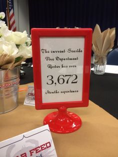 Fire department banquet - IKEA Tolsby double-sided frame $1.49, fire dept statistics as table numbers, B&W photo on reverse.   #firemen #firefighter