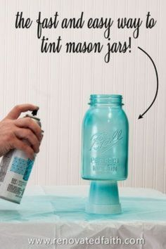 Forget painting mason jars with Elmer's glue or mod podge! This is the easiest way to tint glassware or lanterns any color without messy food coloring & they are waterproof! Tinting mason jars blue is just part of this easy DIY tutorial as it shows how to make the lids look vintage & rustic with paint. Make centerpieces with pink peonies or containers for Christmas gifts. You can also make pink painted mason jars for baby showers! Tinting Mason Jars Diy, Spray Paint Mason Jars, Tinted Mason Jars, Frosted Mason Jars, Colored Mason Jars, Glitter Mason Jars, Blue Mason Jars, Mason Jar Crafts, Mason Jar Diy