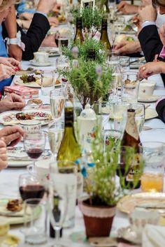 Trestle table dining on mismatched vintage china - Hog roast on vintage china - real weddings - www.thevintagehire.com