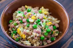 Quinoa Fried Rice Recipe Side Dishes, Main Dishes with cooking oil, eggs, diced ham, green onions, garlic, fresh ginger, frozen peas, quinoa, soy sauce, fish sauce, ground black pepper