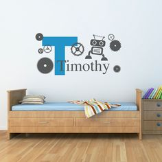 """Initial with Boys Name Wall Decal - Robot & Gears Decal - Personalized Boy Name - Robot Decal - Large. The Robot, Gears & Initial with Boys Name Wall Decal is available in the colors of your choice. See the color chart for your options. Colors pictured are Light Blue & Dark Grey. The photographs are for a reference be sure use the measurements when ordering. Size - 51.5"""" wide by 25.3"""" high (as pictured) Initial size is 23"""" high. Decal size varies due to length of name and placement of..."""