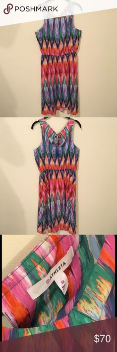 Athleta Colorful Abstract Printed Tassel Dress Athleta dress with a Shift style body- a slightly cinched waist and is Sleeveless. Back has a peep hole with blue Tassel strings. Very soft fabric and is a size medium. Worn once , I am a small and should have bought a size small! Athleta Dresses Midi