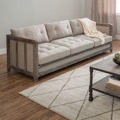 This beautiful Creston sofa features comfortable and durable fire retardant foam cushioning wrapped in beautiful beige linen fabric. The solid wood framing features a reclaimed finish for a rustic-chic touch to any overall sophisticated look.
