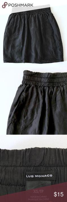 Club Monaco Silk Skirt Black silk skirt from Club Monaco.  Has pockets! Good used condition.  Minimal wear. True to size. Smoke free home. Club Monaco Skirts